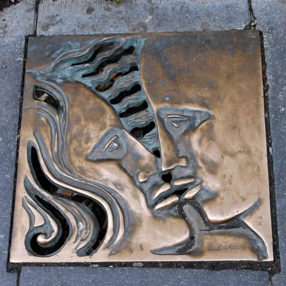 Brussels street art drain cover