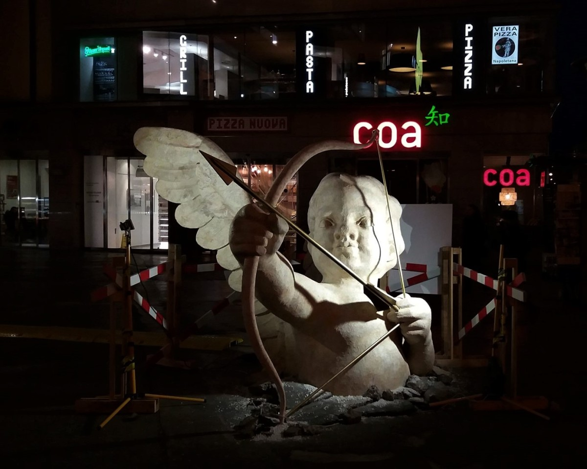 A cupid statue emerging in Prague