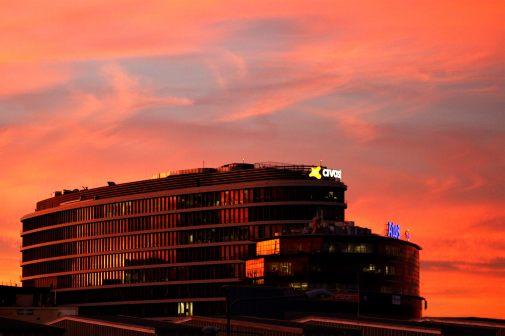 Avast building with colourful sunset sky